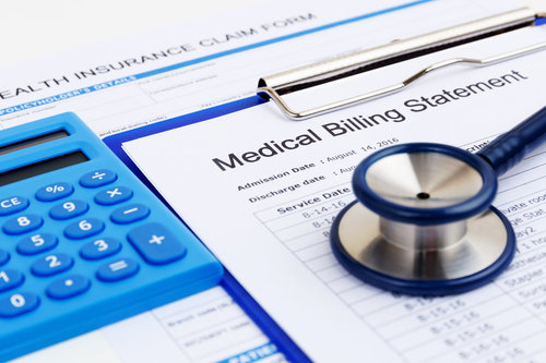 Medical bill and health insurance form with calculator