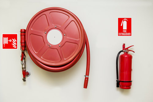 Fire hose reel and fire extinguisher with signs