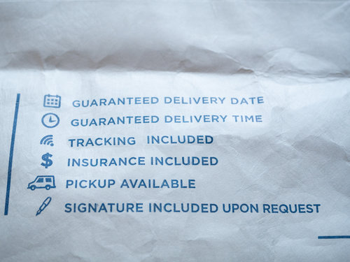 part piece of envelope mail post office signs service of delivery time date tracking signature pickup insurance guaranteed